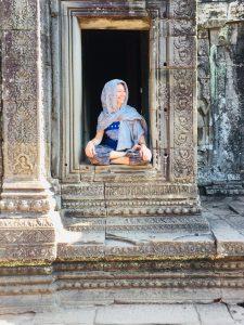 Seating in Angkor Wat. Meditation