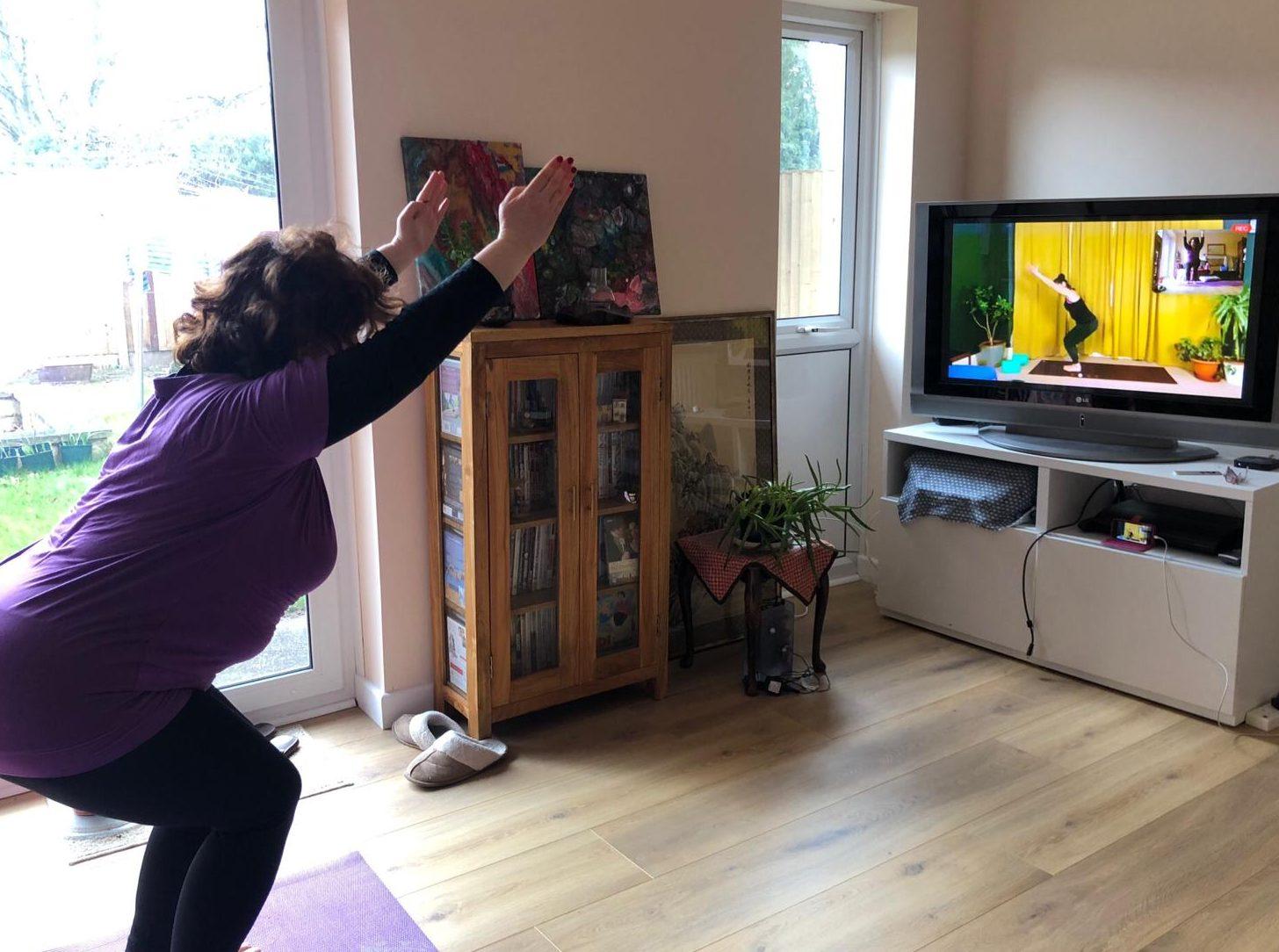 Student doing yoga with Montse Gili