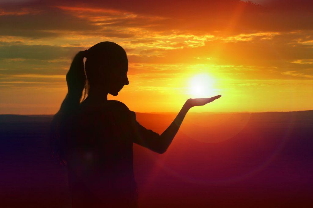 woman 'holding' the sun